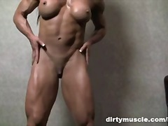 Muscular brunette plays with big clit.