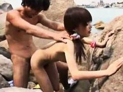 Japanese slut at the beach fucked and sucking.