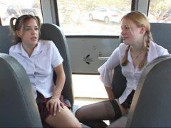 Two teen schoolgirls suck cock on bus.