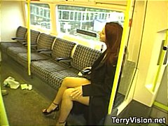 Brunette is on a public train and flashing while others watch.