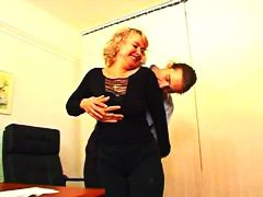 Mature secretary seduces him in the office.