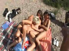 Three german wives have fun on the beach.