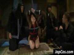 Tied up asian slave gets a rough face fucking from her master.