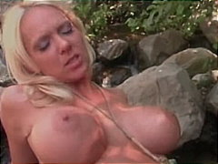 Big boobs and sexy body by the river.