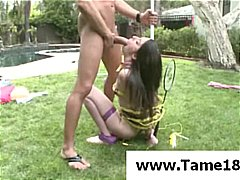 Brunette teen slave is taken outside for a hot bang and blowjob.