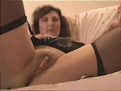 Busty mature strips down and shows off her pussy on webcam.