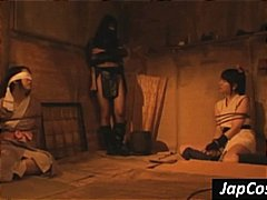 Asian slaves are tortured by their mistress in the dungeon.