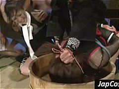 Two asian slaves get tied up and tortuned by water dunking.
