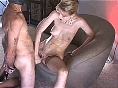 Mistress strokes slave and takes him in pussy.