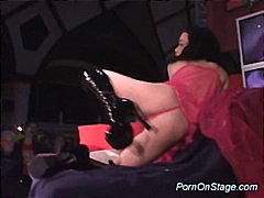 Porn on stage with sexy babe isnerting hard dildo sex.