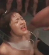 Young asian bitch gets several men to spray her with cum on the face.
