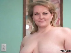 Chubby blonde housewife exposes herself.
