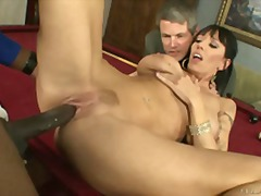 Big breasted milf fucks a big cock as her husband watches on.