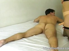 Sexy domina penetrating the horny guy onto bed.