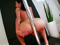 Slutty tranny dances around a pole and rubs her hard cock!.
