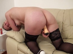 This mature pussy likes to play sex game onto her bed.