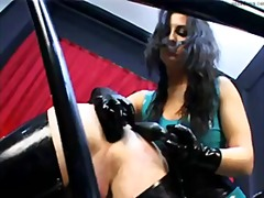 Mistress fucks her slave in the ass with strapon.