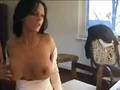 Rubbing her pussy in front of her webcam.