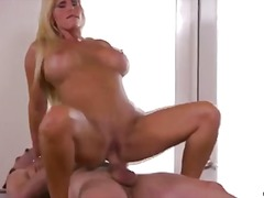 Milf gets cumshot across big tits.