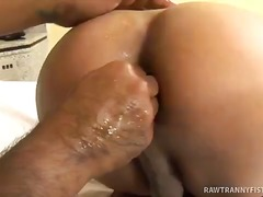 Beautiful she-male gets entire fist up her ass!.