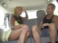 Slutty chick blows him in the back of a car.