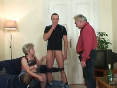 Naughty granny takes two cocks.