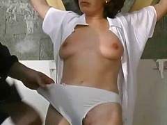 Tied sexy brunette gets her hot ass spanked hard.