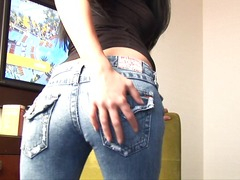 In skintight jeans she teases her ass.