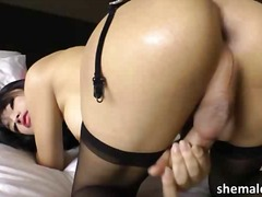Slim busty asian shemale bee masturbates.