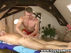 Straight hunk gets hard for gay masseur.