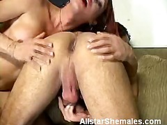 Redhead shemale mouthing our shaft.