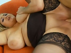 Chubby blonde in stockings fucked in shaved pussy.