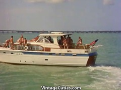 Unclothed nudist party boat.