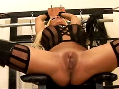 Blond-haired slave milf with legs apart.