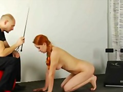 Slave redhead babe is getting trained.