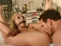 Pretty blonde gets bondaged and punished.