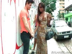 Tranny hookers suck his dick outdoors.
