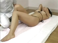 cute japanese babe gets her sweet wet pussy pleasured by doctor.
