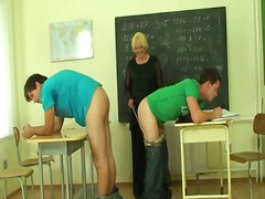 Perverted old teacher takes two cocks.