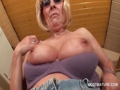 kinky mature in glasses stripping and teasing her boobies.