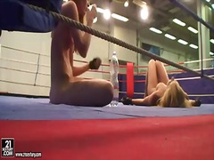 Cindy hope and sophie moone get a break after their hardcore lesbian wrestling on the floor int he wresting ring.