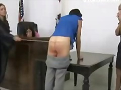 tall girl getting her ass spanked red with stick by the woman judge on the desk to avoid jail.