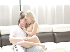 luxury blonde copulating on white couch.