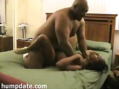 Big black guy fucks a tied skinny ebony babe.