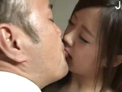 Hot asian babe kissing.