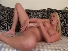 sexy blonde babe has all the fun by herself as she plays with cunt and inserts dildo.