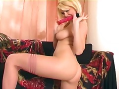 Masturbating in thigh high lingerie and high heels.