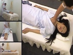 Beautiful japanese gets fingered in a spy cam massage video.