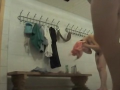 Working spy cam admiring hot booty of change room girl.