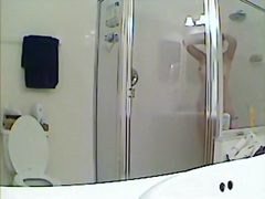 Spy cam shower vid with girl hiding body under towel.